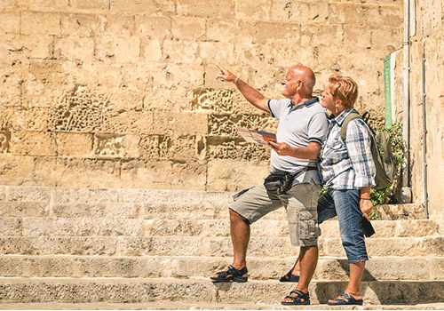 Bigstock-Happy-Senior-coiple-exploring-107889212-walking-tours-500X350